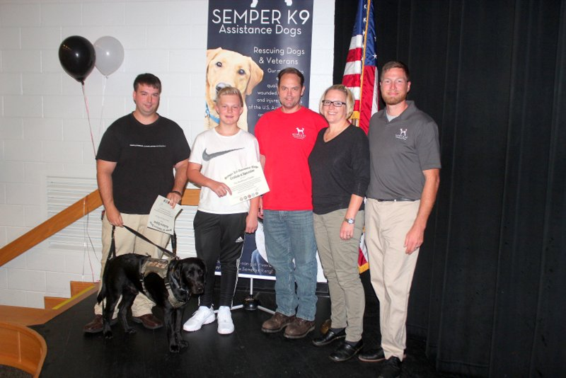 Semper K9's Vinny, his handler, K9 Coach Family and our Executive Director Christopher Baity.
