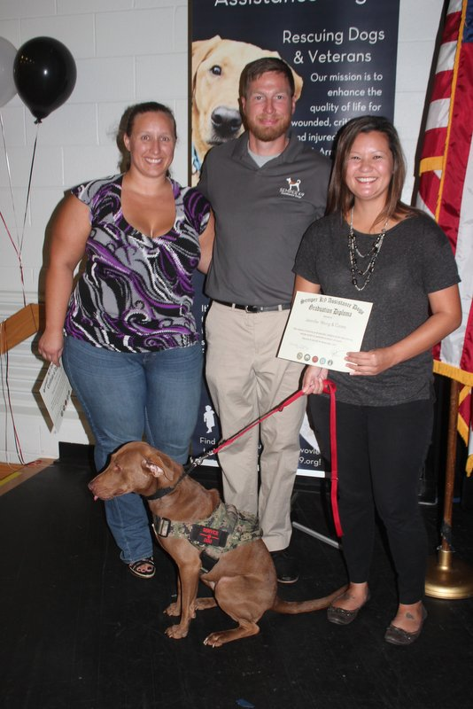 Semper K9's Casey with her handler, Executive Director Christopher Baity and her Operation Paws for Homes Foster Stephanie.